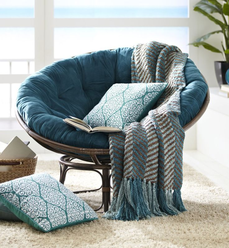 Changing the cushion of the classic Pier 1 Papasan and coordinating with pillows and throws makes it even more comfortable