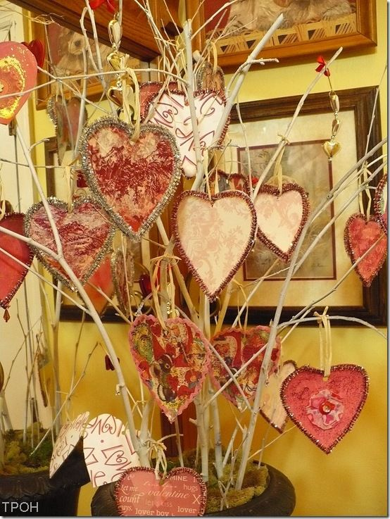 Cardboard cereal box heart cut outs on a twig tree. Valentine's. This would be great in the milk can on front porch!