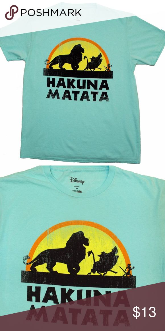 """THE LION KING  HAKUNA MATATA T-SHIRT SIZES-NEW! Show your love for The Lion King with this Hakuna Matata t-shirt  SIMBA TIMON PUMBAA! HAKUNA MATATA This T-shirt is a light weight soft fabric. Very unique favorite color vintage sky blue  Light Distressed graphics. Will look great over time! Official Disney S-19""""  flat underarm to underarm  M-21""""  flat underarm to underarm  L-23""""  flat underarm to underarm XL-25""""  flat underarm to underarm Disney Shirts Tees - Short Sleeve"""
