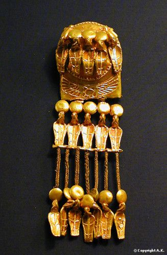 : Earring with uraeus serpents carrying solar disks, the centre of the circular support is engraved with the cartouche of Ramsses XI, gold, height 16 cm, dating from the reign of Ramesses XI, Kom el-Sultan, Abydos, Goldsmith art, Egyptian Civilisation, New Kingdom, Dynasty XX,