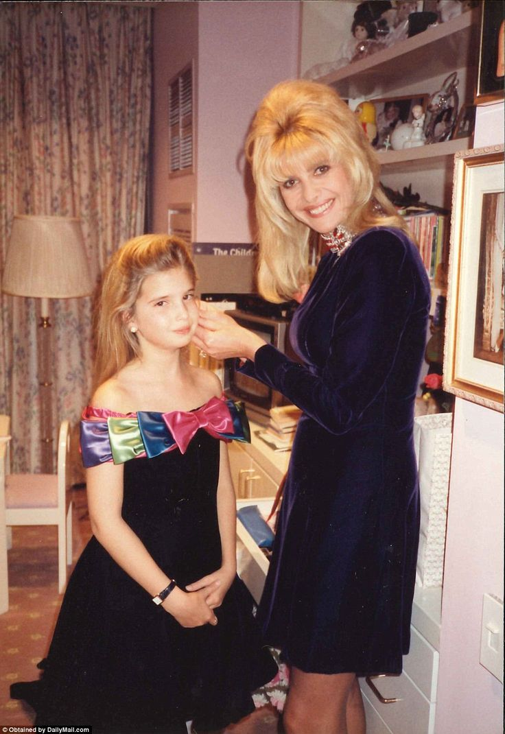 A doting Ivana adjusts her daughter Ivanka's hair as they prepare for a dressy night out t...