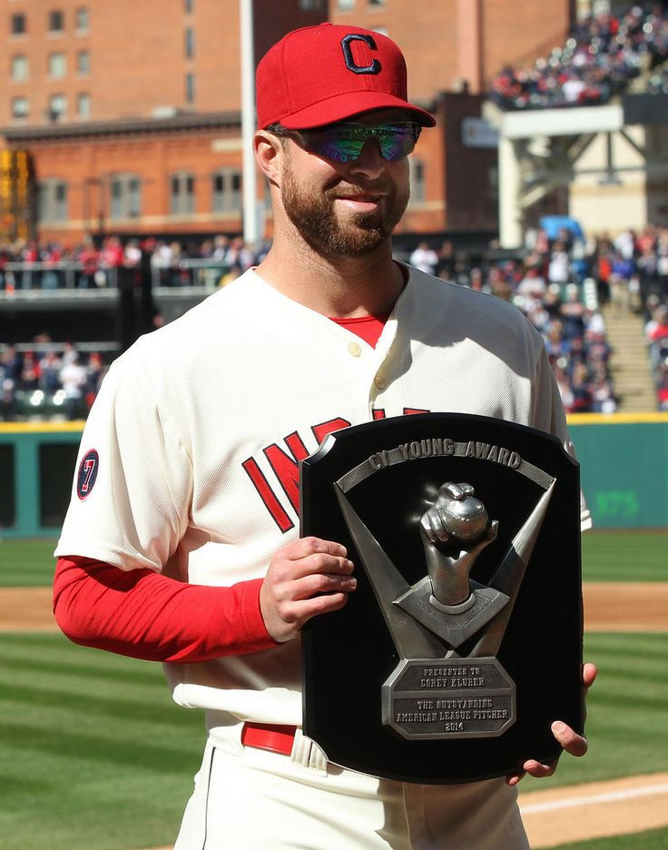 Corey Kluber, with his 2014 Cy Young award for being the best pitcher in the American League in the 2014 season, before the opening game with the Detroit Tigers on April 10, 2015 at Progressive Field.  (Chuck Crow/The Plain Dealer)