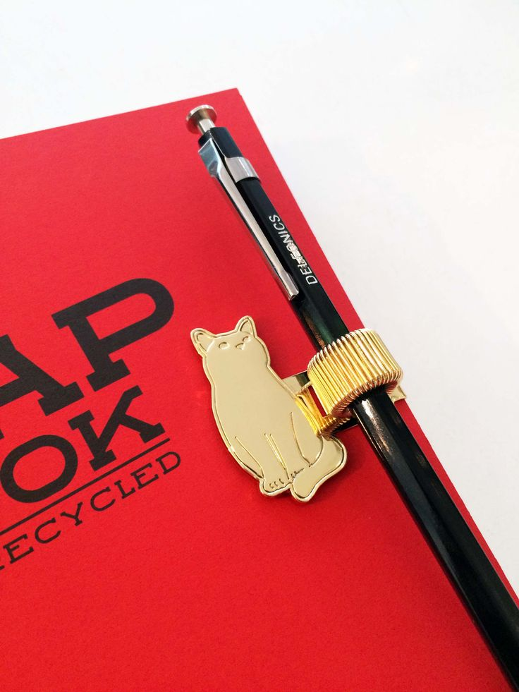 Check out this helpful little cat ready to hold your pen // Available in store // QAGOMA