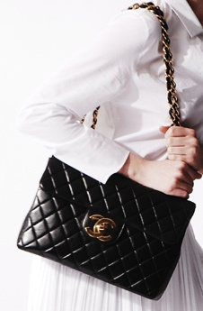 One of my many favorites to carry from day-to-day my Black Lambskin Maxi flap Chanel-Love
