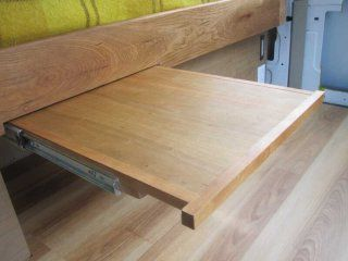 'hidden' extension shelf under bed. All cherry hardwood and some cherry ply