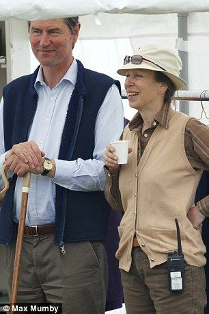 Family day out: Princess Anne and her husband Tim Laurence watch the action