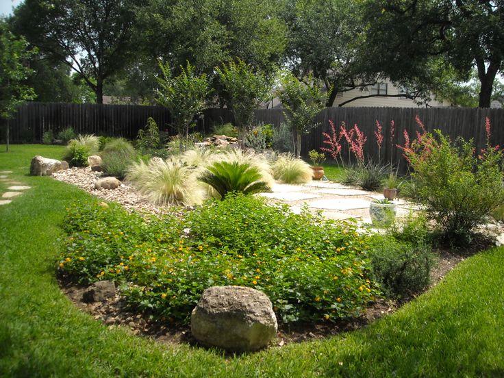 Backyard landscape island of native plants surrounding a