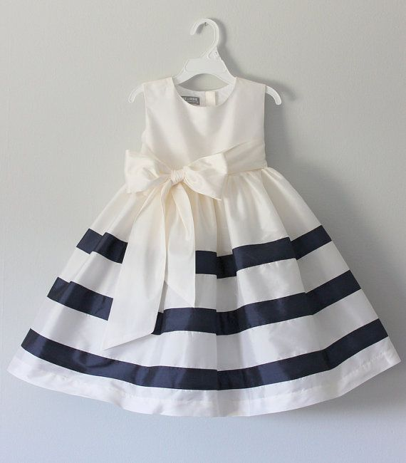 Navy striped skirt Fitted bodice Full skirt Sleevless Empire waist Removable sash Tea length Fully lined Hand wash Dress available in many colors.
