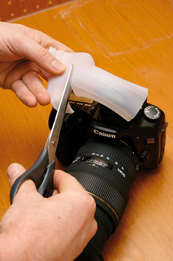 DIY Photography Hacks: soften pop-up flash   with an empty milk carton.  Cut the handle off the milk carton and cut a slit   lengthwise down the center.  Stretch it over the flash and trim off the   excess.
