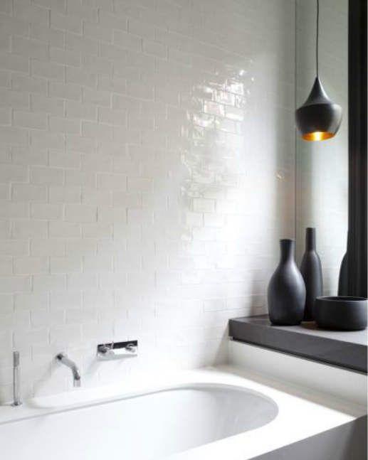 Love the simple white tile  Tom Dixon light for a bathroom!