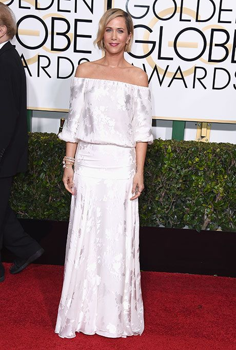 Brides.com: . Kristen Wiig. Kristen Wiig bent toward bohemian in an ivory off-the-shoulder dress that featured three-quarter length sleeves. The actress accessorized with bright red lipstick — and husband Hayes Hargrove, of course.