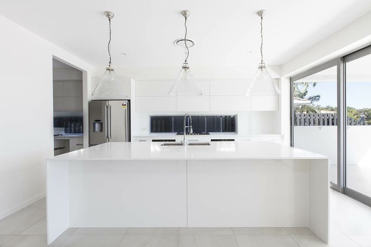 thin, white stone benchtop with waterfall edges