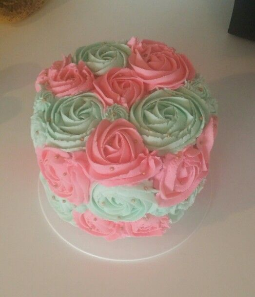 Mint green and pink smash cake with gold pearls.