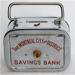THE MONTREAL CITY AND DISTRICT SAVINGS BANK. A rectangular satchel bank, with rounded corners. Coin