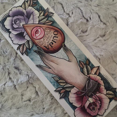 Ouija planchette with hand and flowers; I love the softer colors and think it would look beautiful as a thigh or leg tattoo.