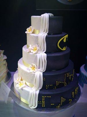 Try this unique idea for your cake! Half for the Bride and half for the Groom! Doesn't have to a super hero. Could be cars or a sport team. Cute! The guys will love it too.