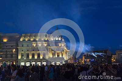 BUCHAREST, ROMANIA - JUNE 1: Large crowd at Cie Off company Paraboles show during the Fifth B-FIT International Street Theater Festival on June 1, 2013 in George Enescu Square, Bucharest, Romania.