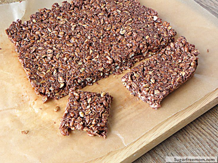 No Bake Chewy Cocoa Granola Bars: includes crispy brown rice cereal, rolled oats, shredded coconut, cocoa powder, flax, sunflower seeds, coconut butter, honey, & vanilla