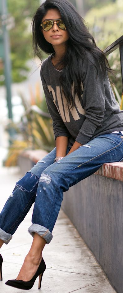 Street Style Denim - love the difference between hard with the heels and soft with the relaxed denim and oversized sweatshirt