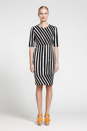This dress is a combination of straight, vertical and diagonal lines. The…