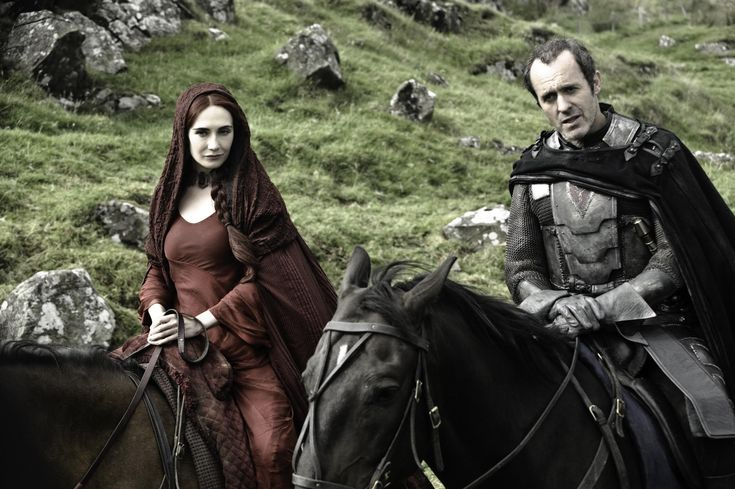 "King Stannis Baratheon (Stephen Dillane) with Melisdandre ""The Red Woman"" (Carice Van Houten) from ""Game of Thrones"""