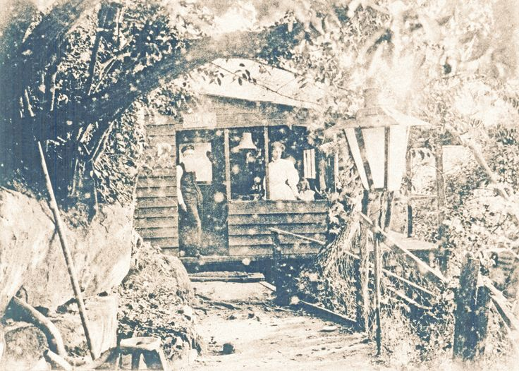 """Curlew Camp, Little Sirius Cove c1907 """"Dining department Curlew Camp"""". -a small weatherboard hut for the use of campers and visitors of the time to take meals indoors. It was founded by Sydney clothing manufacturer, Reuben Brasch, who enjoyed rowing across the harbour and camping in this particular cove. He established the camp on the eastern side under what has become the western boundary of the Zoo. It became popular with artists  Arthur Streeton and Tom Roberts"""