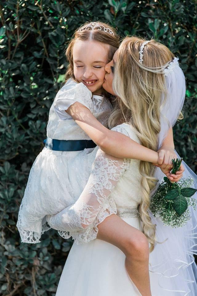 Bride kissing flower girl at Caversham House  Timika Prygoda