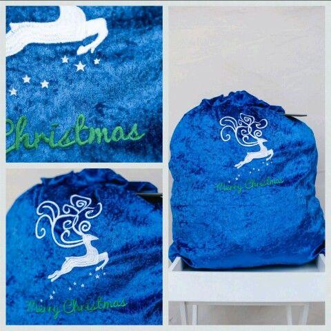 Blue Christmas Sack just for the boys. Love the reindeer. Luxurious velvet. www.thegiftsack.co.za