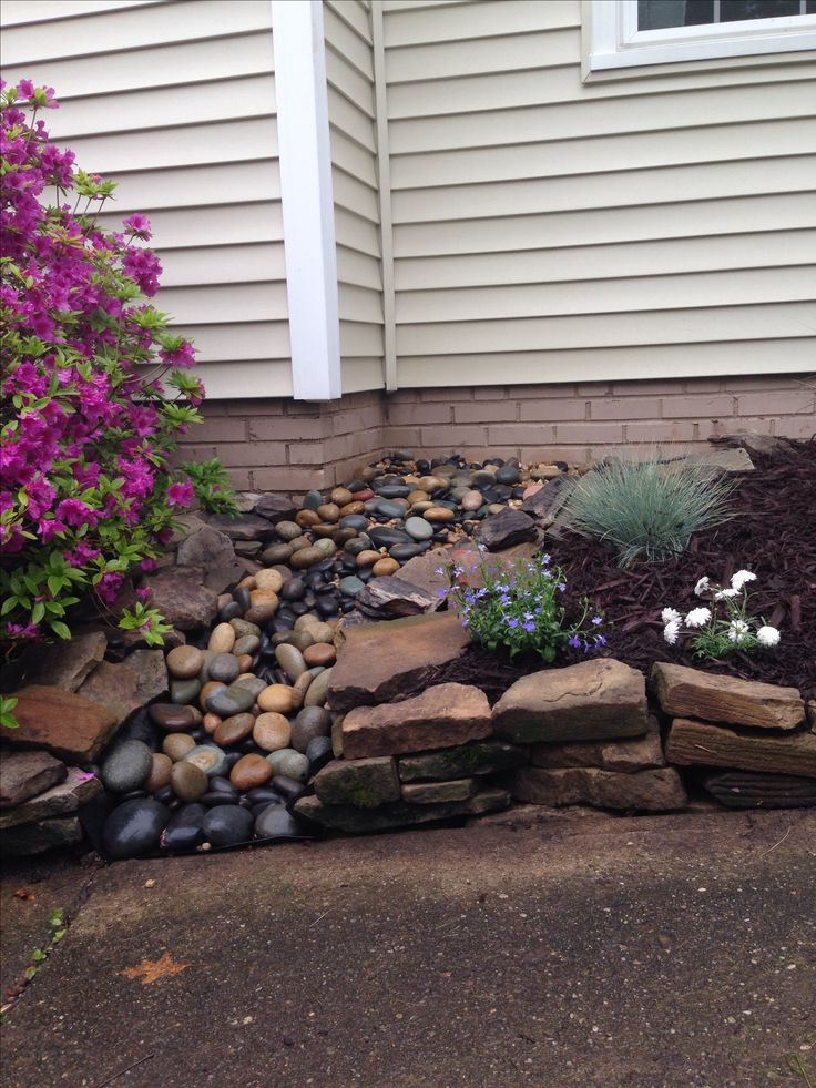 Dry creek that comes to life when it rains and the gutters overflow. Used pond liner, flag stone for edges and Mexican beach stones for fill.