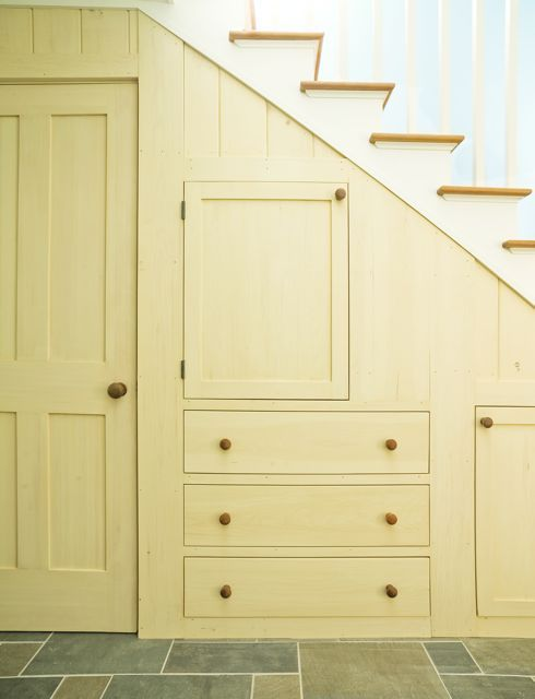 Shaker like storage under stairs, door to basement (would allow kitchen storage at the end of the stair case.)