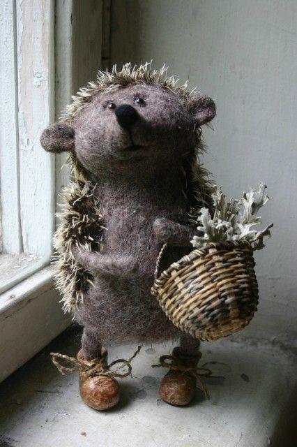 Pixie, the needled felt hedgehog, has a basket of flowers