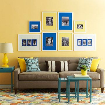 A symmetrical arrangement creates a striking and simple focal point. All-white frames and mats in three colors unify this grouping. Using the same frames creates homogeny.
