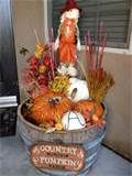 Fall decor in a whiskey barrel | Fall and Halloween