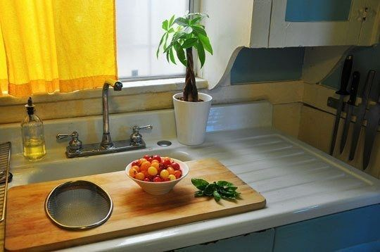 Keep an over-the-sink cutting board handy to temporarily expand your counter space. | 31 Insanely Clever Ways To Organize Your Tiny Kitchen
