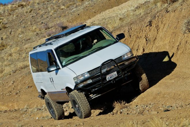 Check out a 1998 Chevy AWD Astro Van that we would love to drive and wheel thanks to its Dana 44 front axle and Chevy 350 V8, whatever you do don't call it mini