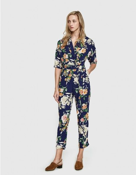 3c1bd67362a4 Printed jumpsuit from Farrow in Blue. Allover floral print. Band collar.  Notch lapel. Exaggerated drop shoulders. Half sleeves with tacked cuffs.