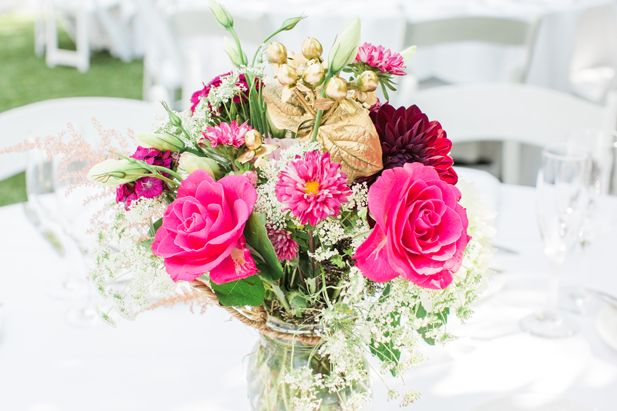 Pink and metallic gold wedding centerpiece with painted flowers   Jessica Grazia Mangia Photography   See more on My Hotel Wedding: https://www.myhotelwedding.com/blog/2016/11/11/north-hollywood-garden-wedding-garland/