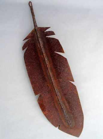 Saw blades, discarded rebar and metal scraps are welded to create these feathers