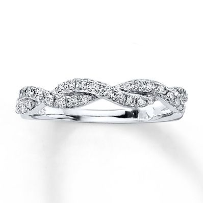 An elegant symbol of your enduring love, this anniversary band for her features two entwined ribbons of sparkling diamonds. Fashioned in 10K white gold, the ring has a total diamond weight of 1/6 carat. Diamond Total Carat Weight may range from .145 - .17 carats.