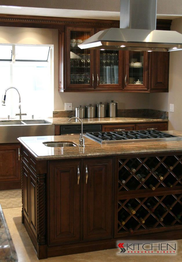Stacked wine racks built into the kitchen island for Bristol chocolate kitchen cabinets