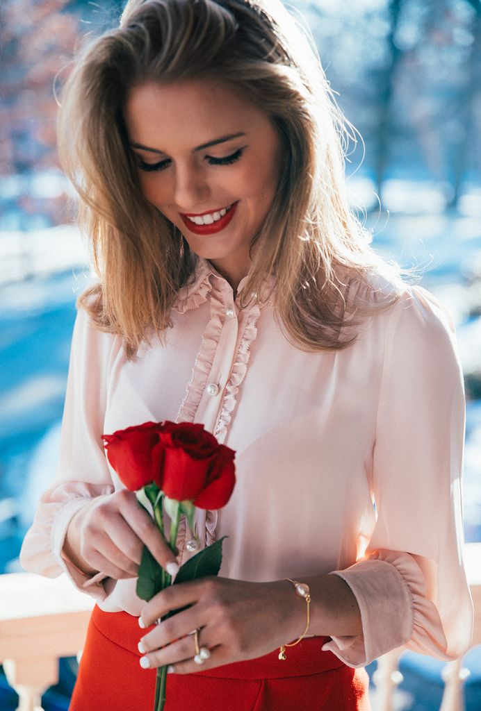 Valentine's Outfit idea: Pink ruffle shirt, red skirt, pink bubbly bracelet