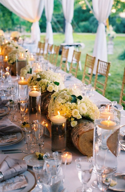 Table centerpiece created in a birch log overflowing