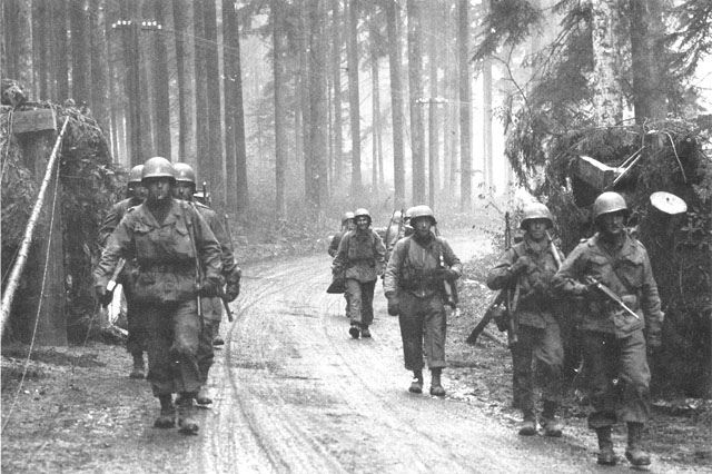 GIs of Fox Company, commanded by Captain H.D. Smith, of 39th Infantry Regiment, 100th Infantry Division, on the move in Lorraine, 7 Nov 1944