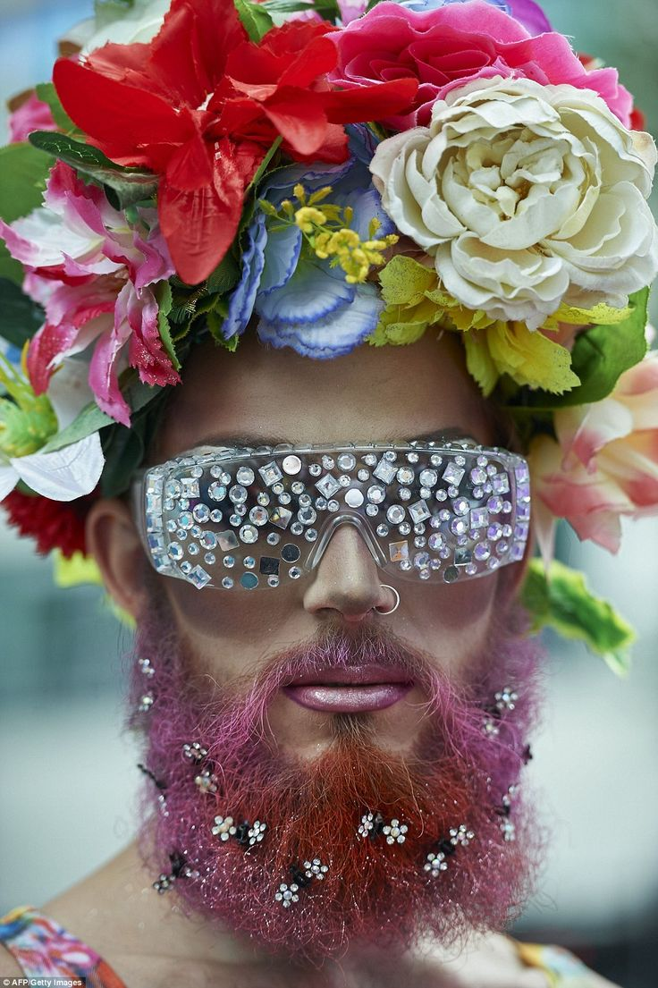A member of the Lesbian, Gay, Bisexual and Transgender (LGBT) community takes part in the annual Pride Parade in London