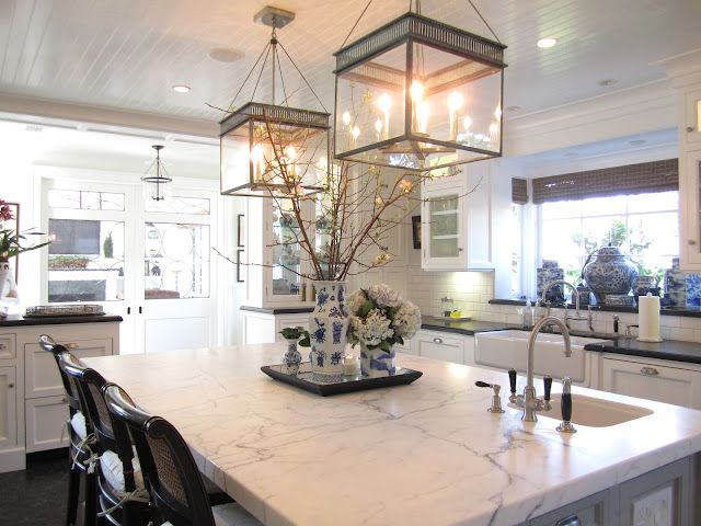 Kitchen Design With Glossy White Beadboard Ceiling Accented With Urban  Electric Chisholm Hall Lanterns Over Calcutta Marble Kitchen Island.
