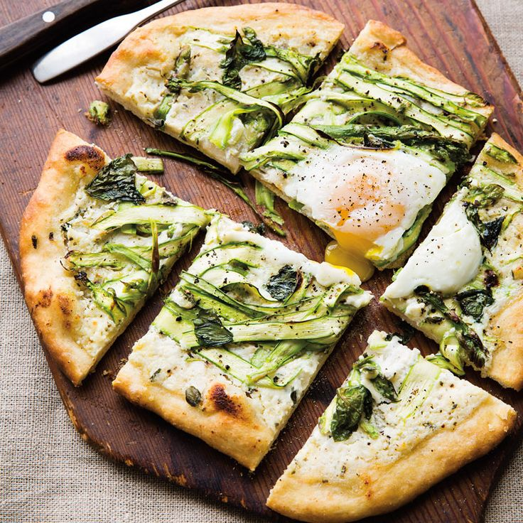 Eggs on pizza may seem like an odd idea, but one taste of this asparagus and egg pizza and you'll be hooked. Warm yolk adds creaminess to the ricotta sauce.