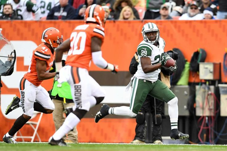 Jets vs. Browns:  October 30, 2016  -  31-28, Jets  -   Bilal Powell of the New York Jets carries the ball for a touchdown in front of Tracy Howard and Derrick Kindred of the Cleveland Browns during the second quarter at FirstEnergy Stadium on Oct. 30, 2016 in Cleveland.