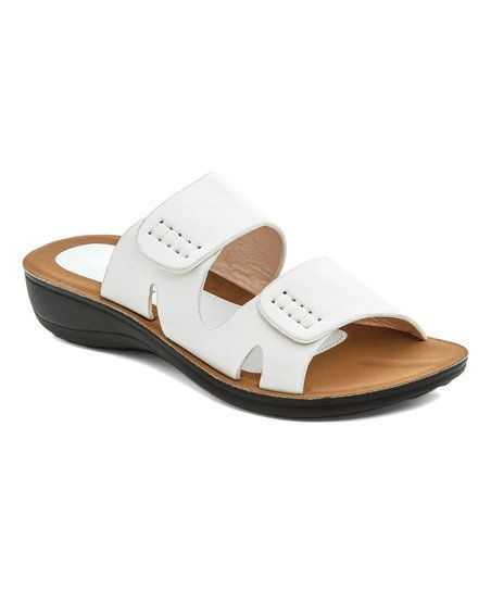 Slide into a classic warm weather style with this trendy sandal boasting bold thick straps and a cushioned footbed for lasting comfort.