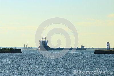 Merchant ships at anchor in the waters of Kronshtadt autumn sunny day. Saint-Petersburg, Russia