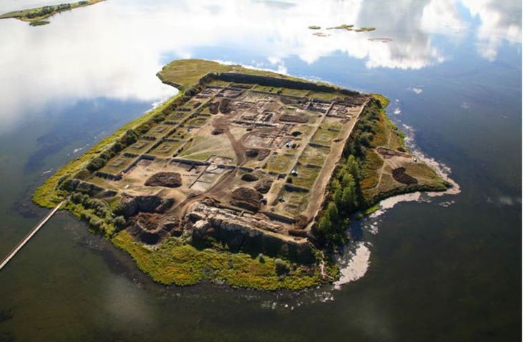 It is one of the most mysterious archaeological sites in Russia – an ancient complex engulfing a small island in the center of a remote lake in the mountains of southern Siberia. At first glance, it appears to be an ancient fortress, its perimeter of high walls constructed to keep out enemies. However, others have proposed the 1,300-year-old structure may have been a summer palace, monastery, memorial complex, ritual center, or astronomical observatory.